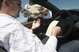 Police officer issuing driver for overspeeding.