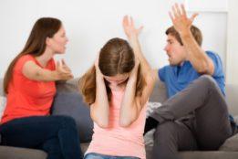Divorced couple arguing for child custody.