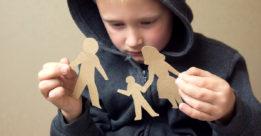 Sad child worried on who's taking him for child custody.